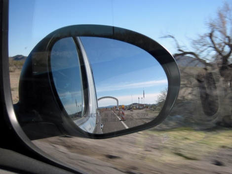 "Checkpoint at the U.S.-Mexican Border in the rearview mirror. Photo Credit: Flicker username, ""Jennoit"""